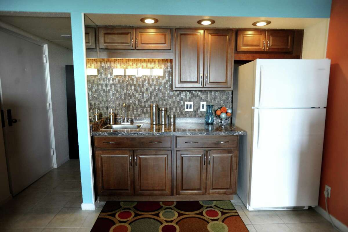The kitchen in Avery's condo was renovated with new cabinets, countertop and sink. Doing away with a full-size stove allowed him to have a full-size fridge. Cooking is done with an electric hot plate, microwave and toaster oven.