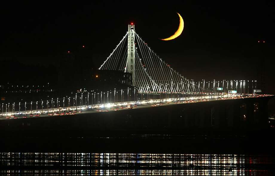 A crescent moon rises above the new tower of the Bay Bridge as seen recently from Emeryville. Photo: Frederic Larson
