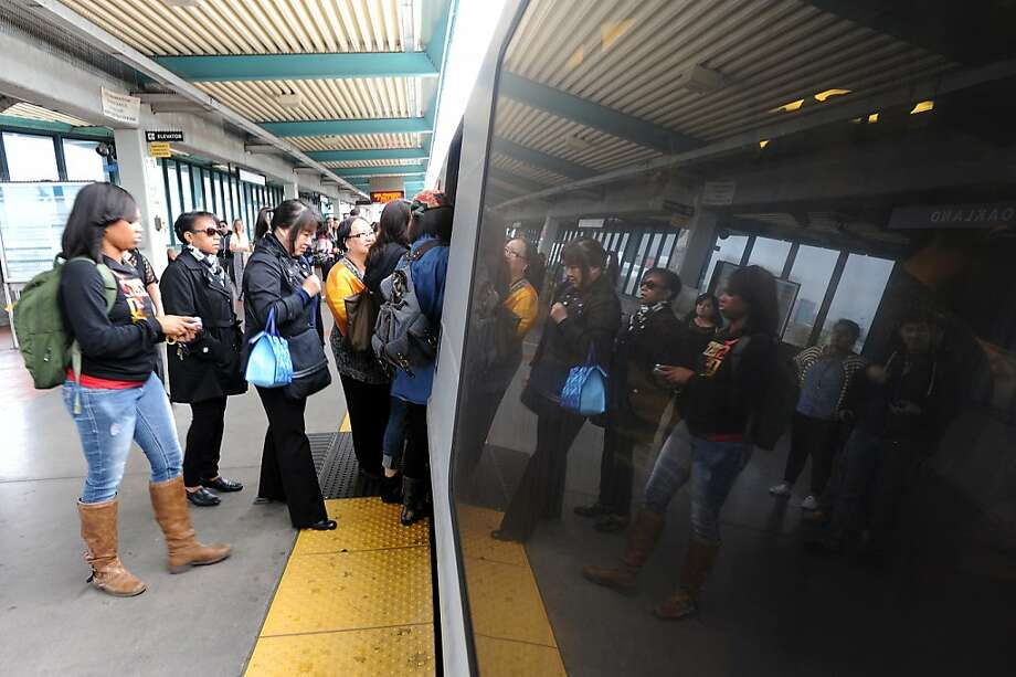 These BART riders in Oakland might find service to S.F. interrupted if no deal is reached by Oct. 10. Photo: Michael Short, Special To The Chronicle