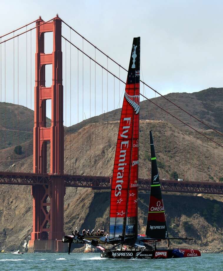 Oracle Team USA (R) races against Emirates Team New Zealand while competing in the first race of the day during the 34th America's Cup on September 12, 2013 in San Francisco. Photo: DON EMMERT, AFP/Getty Images