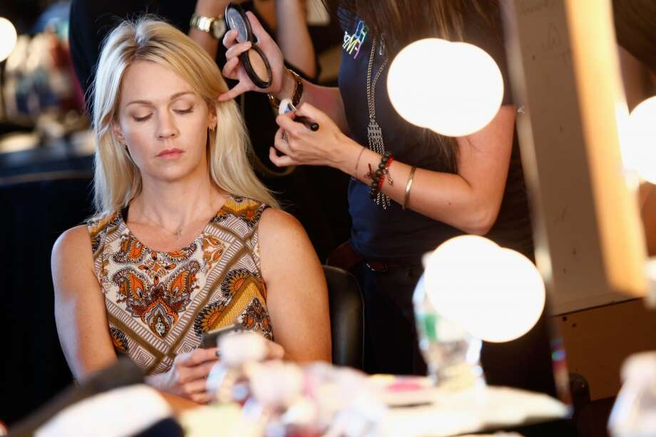 Actress Jennie Garth prepares backstage during the Katty Xiomara show during Nolcha Fashion Week New York Spring/Summer 2014 presented by RUSK at Pier 59 Studios on September 11, 2013 in New York City.  (Photo by Brian Ach/Getty Images for Nolcha Fashion Week) Photo: Brian Ach