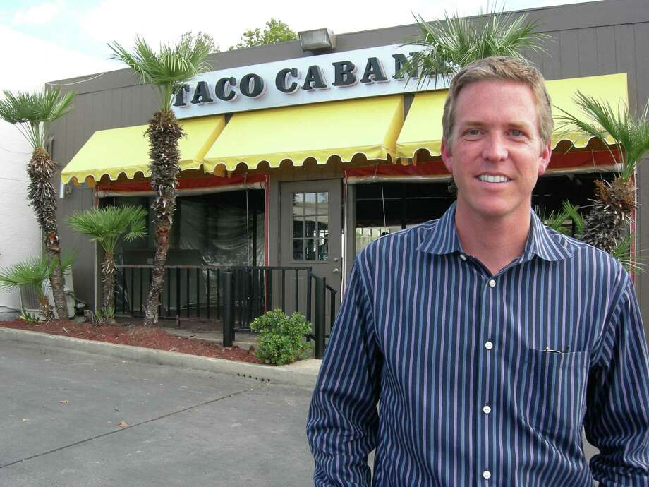 COO Todd Coerver stands in front of Taco Cabana's San Pedro and Hildebrand location, which is restored to how it looked when it opened in 1978 in honor of the brand's 35th anniversary. Photo: Stefanie Arias / San Antonio Express-News