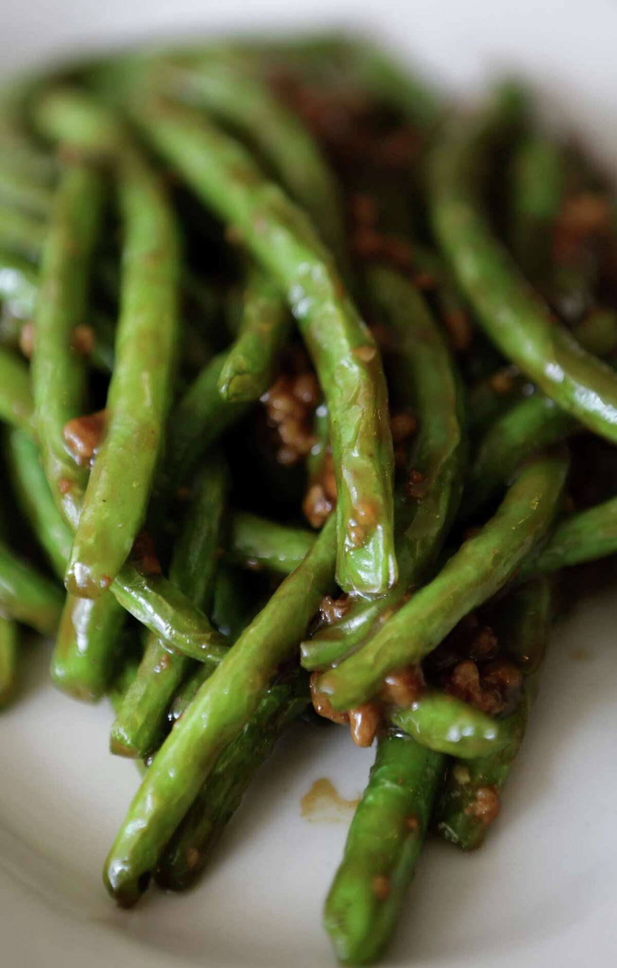 Green beans with pork is among the dishes on the expansive Kim Wah menu.
