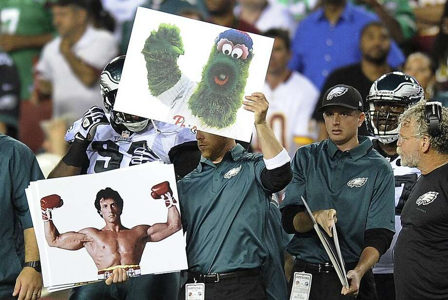Philadelphia icons graced placards used by the Eagles to signal plays. Photo: Nick Wass, Associated Press
