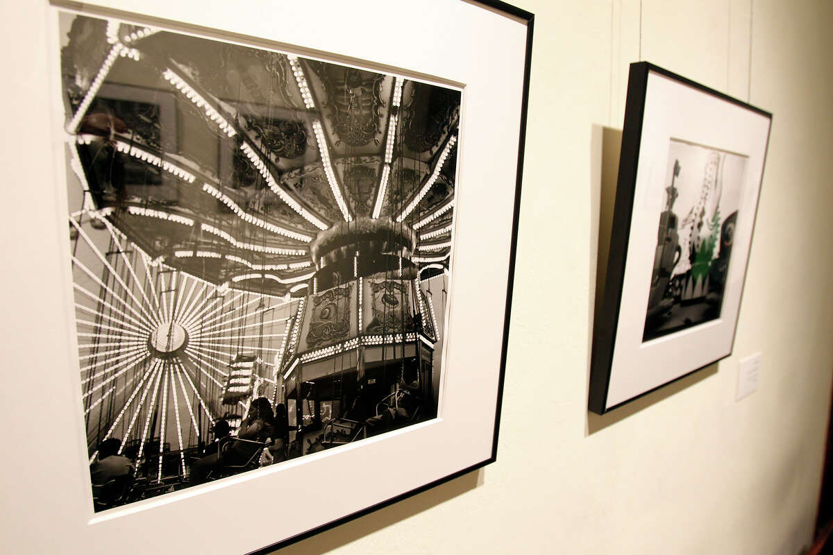 Rebecca Dietz shows her photographs on display at the Southwest School of Art on September 5, 2013.