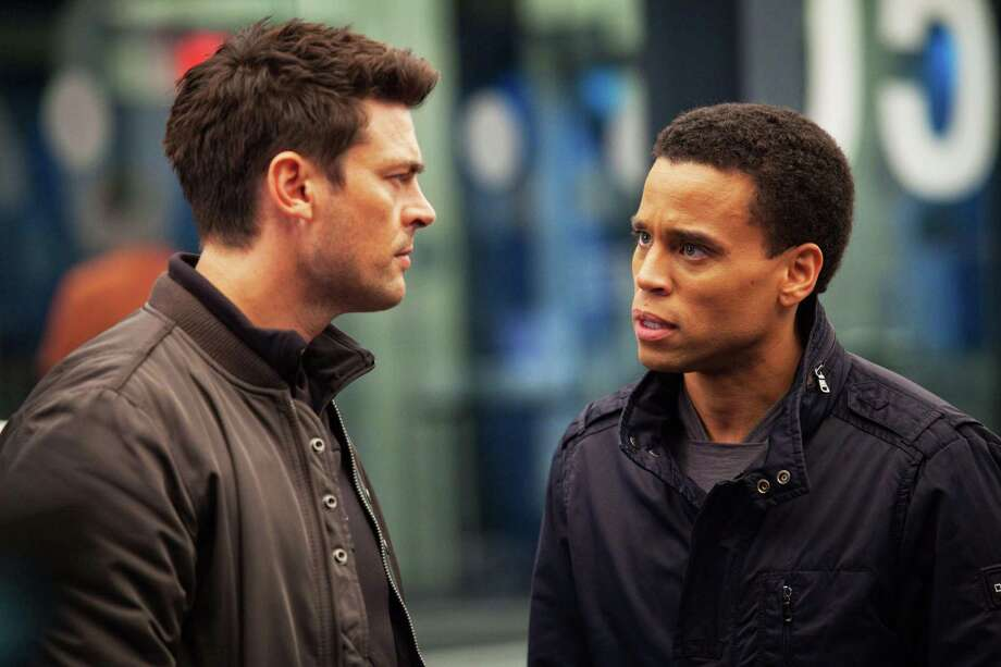 "In ""Almost Human,"" man and machine — played by Karl Urban (left) and Michael Ealy — team up to fight crime in 2048. Photo: Fox"