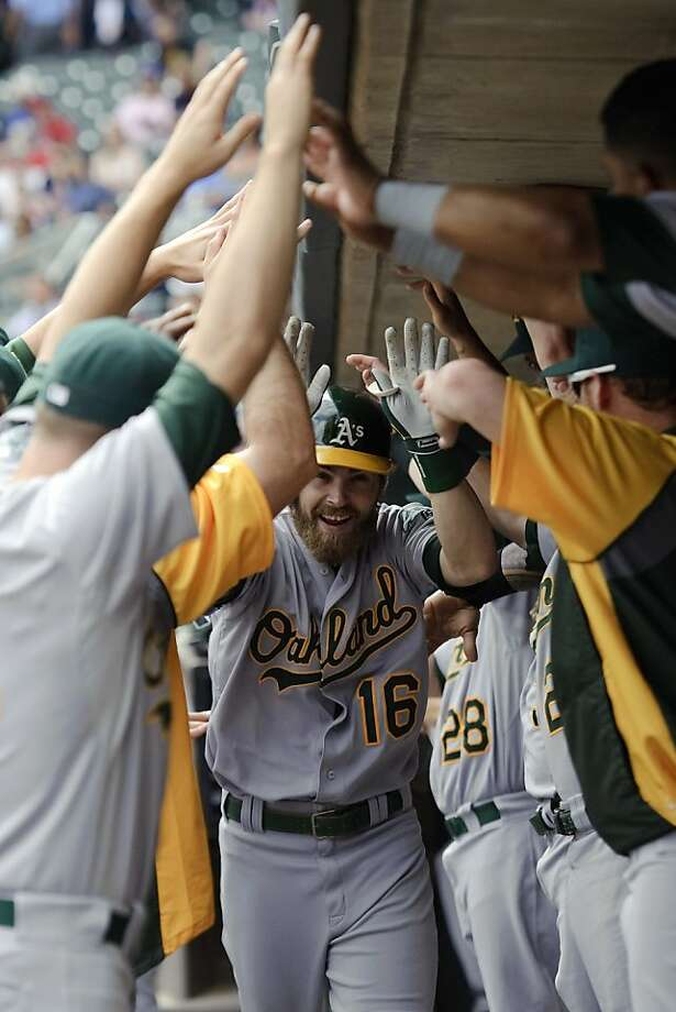Josh Reddick gets the welcome treatment after homering in the eighth. Photo: Hannah Foslien, Getty Images
