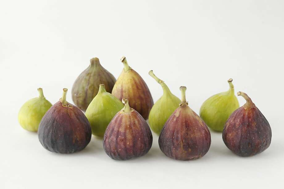 Figs come in several varieties, including the large Brown Turkey, the small green Tevia and the striped Osborne. They can be eaten fresh, sliced on a savory pizza, baked into a tart or cooked for jam. Photo: Craig Lee, Special To The Chronicle