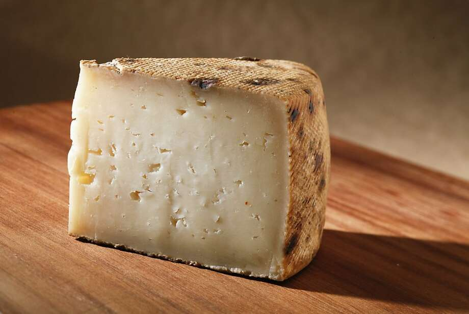 Baserri from Barinaga Ranch in West Marin has a mold-dusted natural rind and a firm ivory interior with many openings. Photo: Craig Lee, Special To The Chronicle