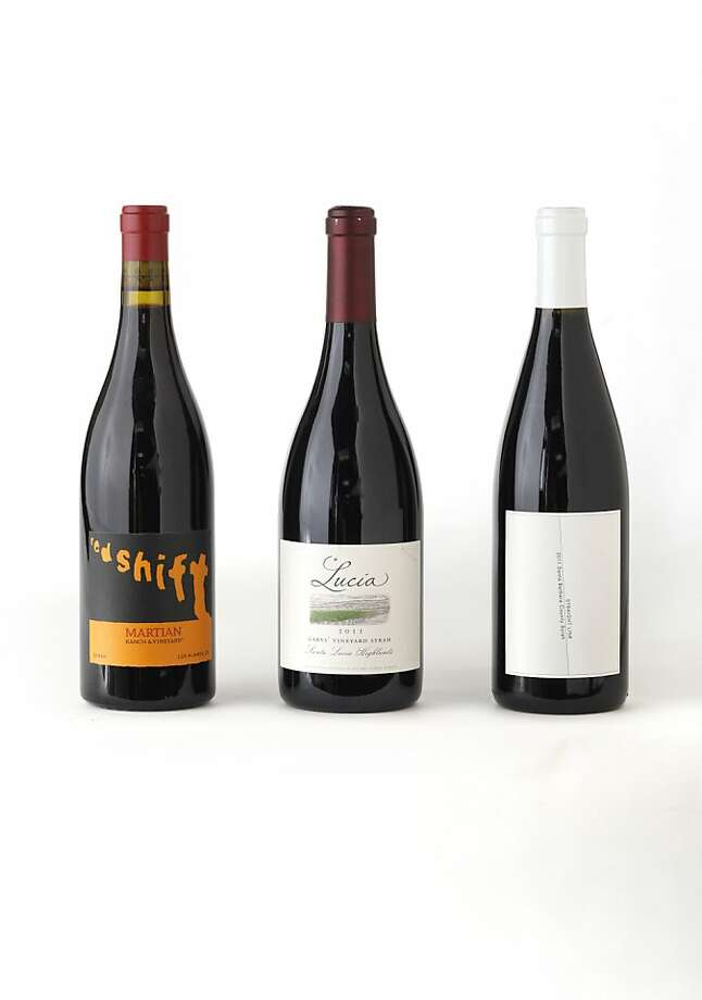 Three bottles of Central Coast Syrah, left-right: 2011 Martian Ranch Red Shift, 2011 Lucia Gary's Vineyard, 2011 Straight Line as seen in San Francisco, California, on August 28, 2013. Photo: Craig Lee, Special To The Chronicle