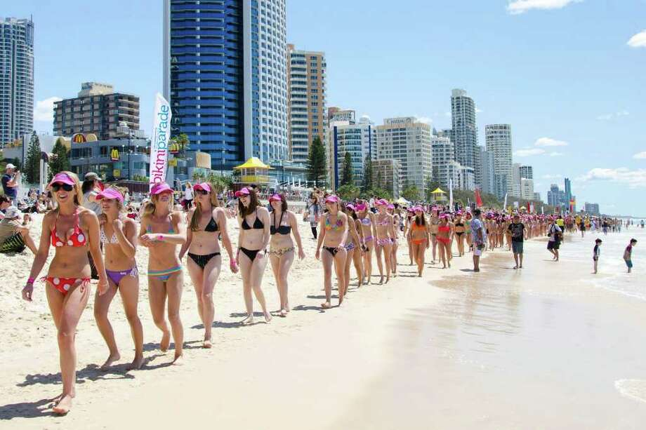 Bikini clad participants parade along Surfers Paradise Beach in Gold Coast City on October 2, 2011 in an attempt to break the Guinness World Record for the longest bikini parade. 357 bikini clad girls paraded on Surfers Paradise beach to break the record of 331 set in 2010 by the Cayman Island Amateur Swimming Association. AFP PHOTO / MURRAY RIX Photo: MURRAY RIX, AFP/Getty Images / 2011 AFP