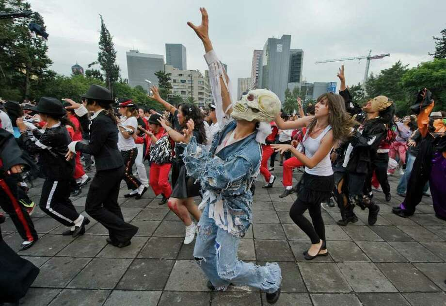 "Mexicans take part in the ""I do dance Thriller"" event which attempts to break the Guinness World Record for the biggest mass ""Thriller"" dance, in Mexico City, on August 29, 2009. Up to 15,000 people are expected to take part in a potentially record breaking mass performance of Michael Jackson's famed ""Thriller"" dance on the day he would have turned 51. Photo: AFP/Getty Images"
