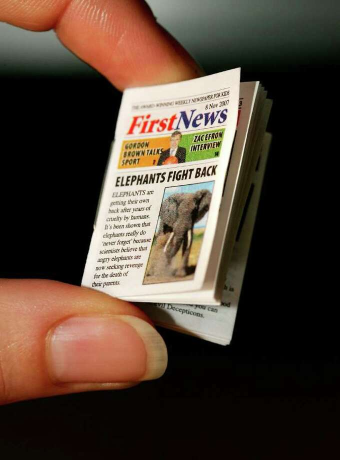 First News gets the Guinness World Record for the smallest newspaper on November 8, 2007 in London, England. The children?s newspaper published the paper for Guinness World Record Day, November 8. Photo: Cate Gillon, Getty Images / 2007 Getty Images