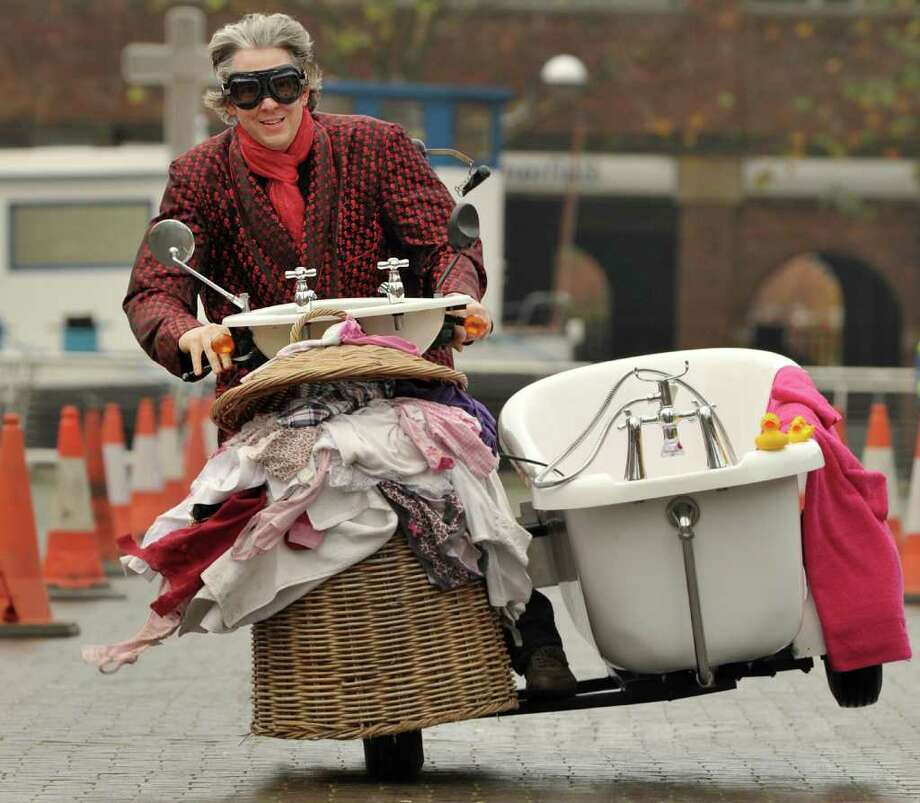 British inventor Edd China rides the worlds fastest toilet with a top speed of 68km/h during a race at the annual Guinness World Records Day in London on November 17, 2011. Wacky Guinness world record holders got together to race their unlikely vehicles like the world's fastest toilet and smallest roadworthy car in London the mark the 7th annual Guinness World Records day. Photo: BEN STANSALL, AFP/Getty Images / 2011 AFP