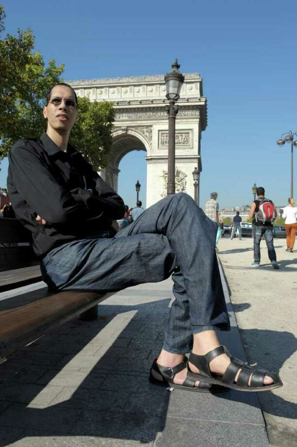Morocco's Brahim Takioullah, who has the largest feet of the world according to the Guinness Book of Records, poses in front of the Arc de Triomphe on the Champs-Elysees on September 29, 2011 in Paris. Takioullah's left foot measures 38.1 cm (1 ft 3 in) while his right foot measures 37.5 cm (1 ft 2.76 in). Photo: BERTRAND GUAY, AFP/Getty Images / 2011 AFP