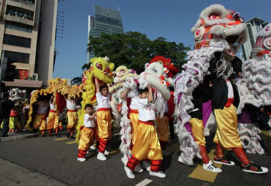Performers take part in an attempt to create a record for the largest dragon and lion dance in Hong Kong on January 1, 2011. The Guinness world record was set after 1,111 lions gathered for the traditional martial-arts dance performance. Photo: ED JONES, AFP/Getty Images / 2011 AFP