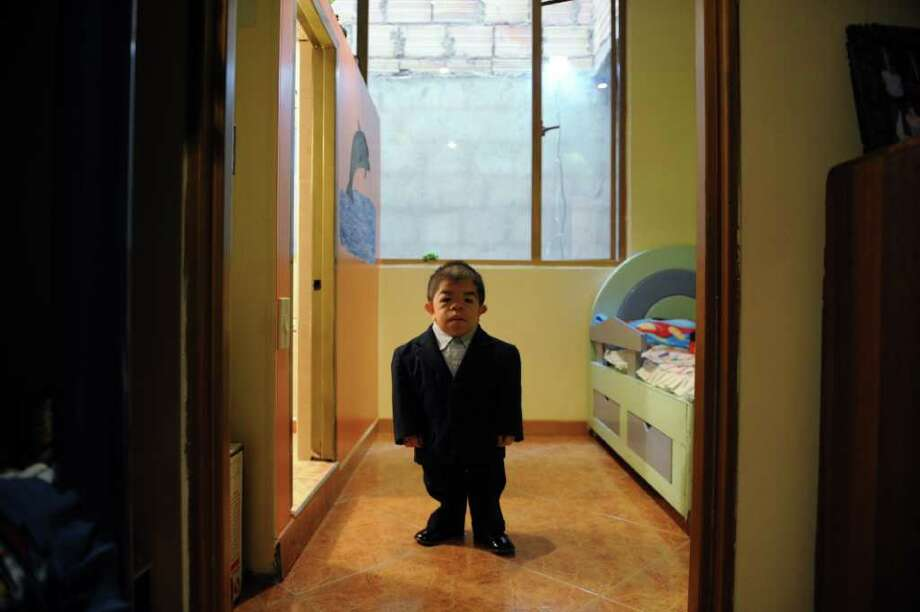 Colombian twenty-four-year-old and 70 centimeters tall Edward Niño Hernandez, the world shortest man as officially certified by the Guinness World Records, is pictured at his house in Bogota on September 7, 2010. Guinness people discovered Niño after the previous titleholder He Pingping of China, who was 4 centimeters taller, died on March 13. Photo: RODRIGO ARANGUA, AFP/Getty Images / 2010 AFP