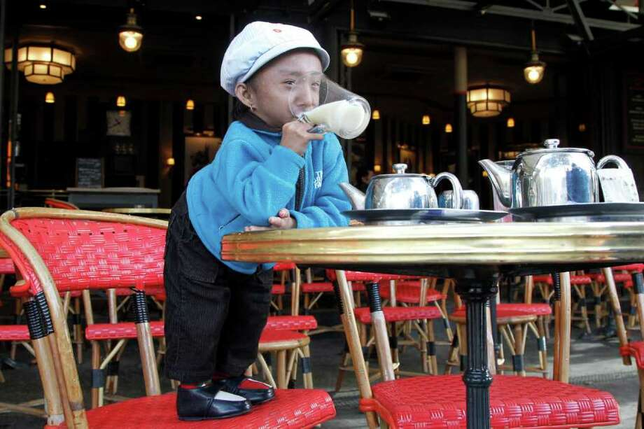 Nepalese Guinness World Record holder Khagendra Thapa Magar, 19, the second world's smallest man with 67 cm (26 inches), drinks some tea in a French cafe in Paris on October 19, 2011. Photo: FRANCOIS GUILLOT, AFP/Getty Images / 2011 AFP