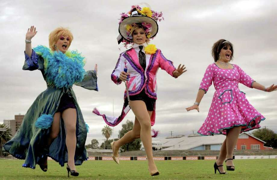 The 'Manly Sisters' warm up before joining an attempt to break the Guinness World Record for 'The Most People Running in High Heeled Shoes', in Melbourne on April 10, 2010. Raced over 80 metres, the attempt was unsuccessful but raised money for a foundation which helps support young adults with cancer. Photo: WILLIAM WEST, AFP/Getty Images / 2010 AFP