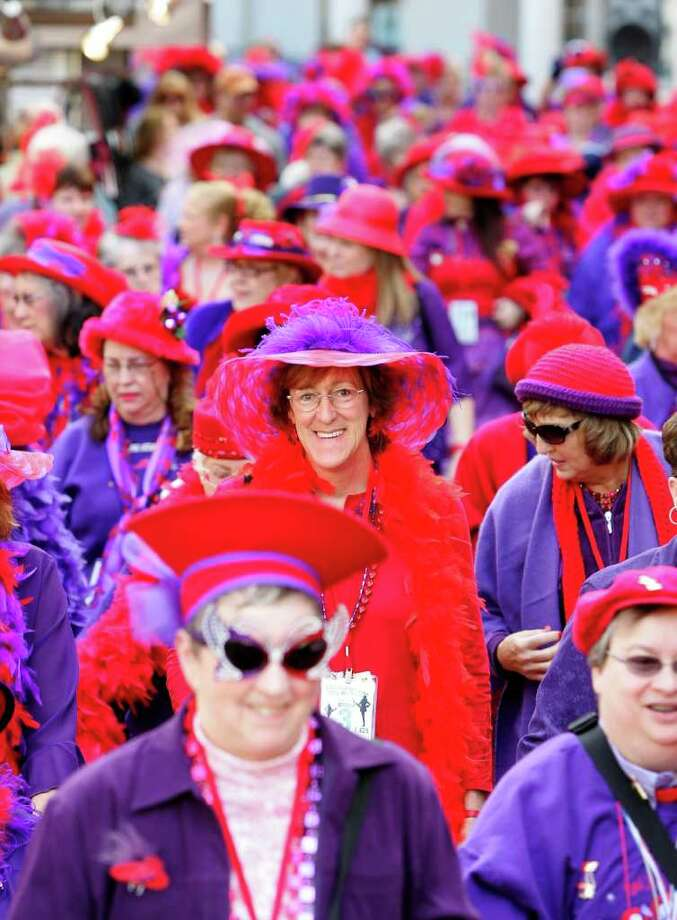 Members of the Red Hat Society crowd a sidewalk after participating in a Guinness World Record attempt for most people in a chorus line January 26, 2008 in Las Vegas, Nevada. About 1,700 members of the RHS lined the Las Vegas Strip to attempt to break the record as part of the celebration of the opening of HATS!, a new musical at Harrah's Las Vegas. Photo: Ethan Miller, Getty Images For Harrah's / 2008 Getty Images