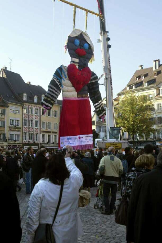The world biggest doll (10 meters high), created by students to celebrate the 25th anniversary of the Higher Institute of Textile Alsace (ISTA) , is presented on November 12, 2011 at the Place de la Reunion, in Mulhouse, eastern France, for its Guinness Book of Records' approval. Photo: SEBASTIEN BOZON, AFP/Getty Images / 2011 AFP