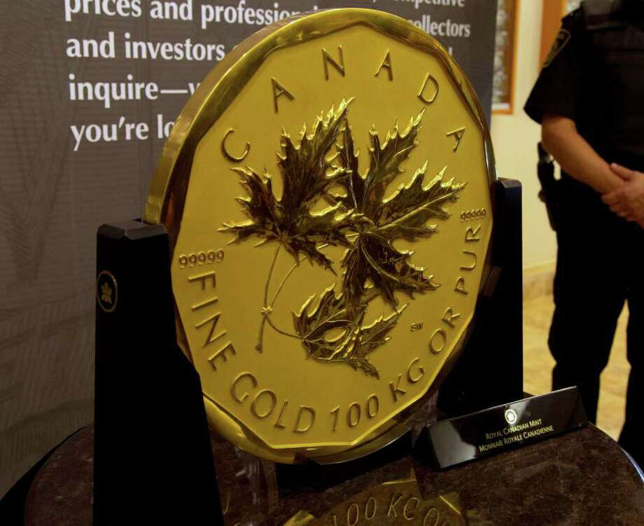 Canada's one million dollar-face value coin, weighing 100kg and made of 99.999% pure gold was on display in Toronto, on November 3, 2011. The large gold coin which had displaced an Australian coin as the world's biggest, but recently lost the title, was on display this week in Canada's largest city. The coin, measuring 50 centimeters across, took over two years to make from design to final product. When it was introduced in 2007 by the Royal Canadian Mint, it set a Guinness World Record. But the Perth Mint reclaimed the record for the world's biggest bullion coin last week when it unveiled a 1,000-kilogram coin. It previously held the title with a 10kg coin until 2007, when the Canadian mint launched its 100kg coin. Photo: ANDREA BELLEMARE, AFP/Getty Images / 2011 AFP