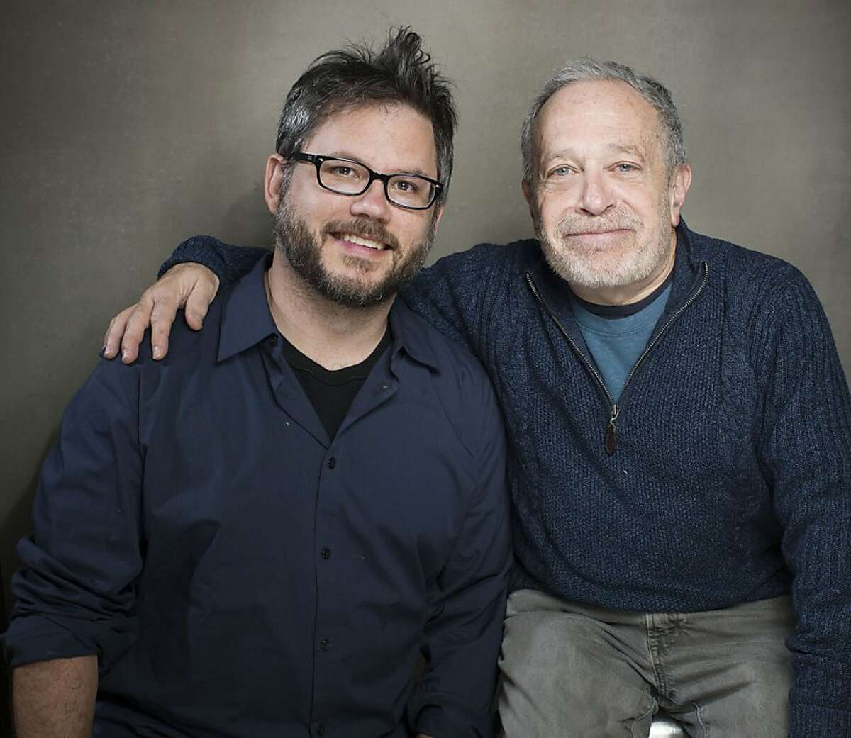 """Former U.S. Labor Secretary Robert Reich, right, looks to raise awareness of the country's widening economic gap between the wealthy and the middle class in the documentary """"Inequality for All,"""" directed by Jacob Kornbluth, left From left, director Jacob Kornbluth and author Robert Reich from the film """"Inequality For All"""" pose for a portrait during the 2013 Sundance Film Festival at the Fender Music Lodge on Monday, Jan. 21, 2013 in Park City, Utah. (Photo by Victoria Will/Invision/AP Images)"""