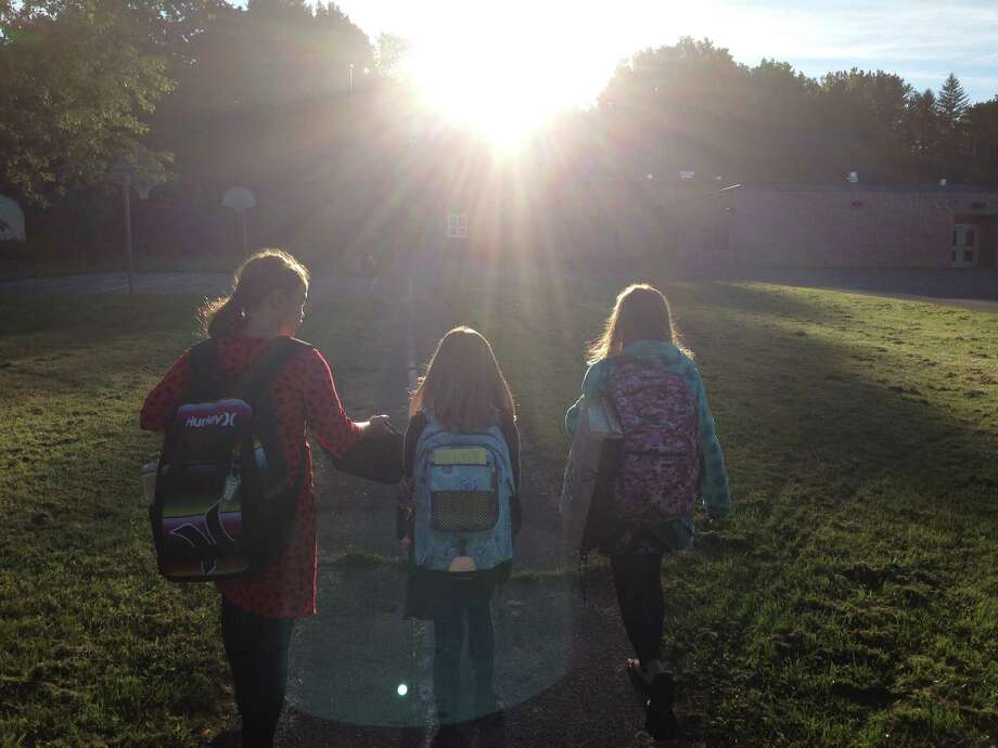 Third-grader Aiylin Rutnik, left, and two friends walk off to their school, Hillside Elementary in Niskayuna, early in the morning of the first day of school. (Erik Rutnik)