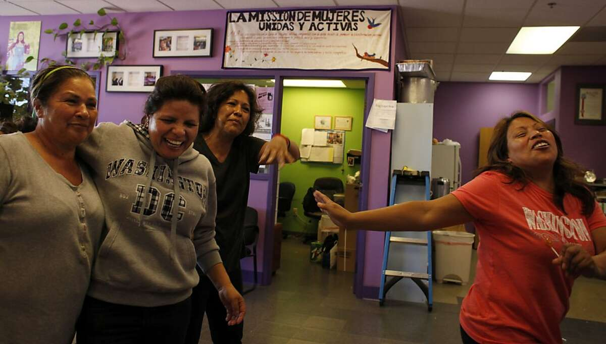 Teresa Molina, left Marta Herrera, Monica Gonzales and Veronica Nieto laugh as they prepare for the Mujeres Unidas y Activas meeting, Thursday September 12, 2013, in San Francisco, Calif. The women in the group are happy because of the California's legislature this week became the first in the nation to pass a law requiring daily overtime pay for an estimated 200,000 domestic workers.