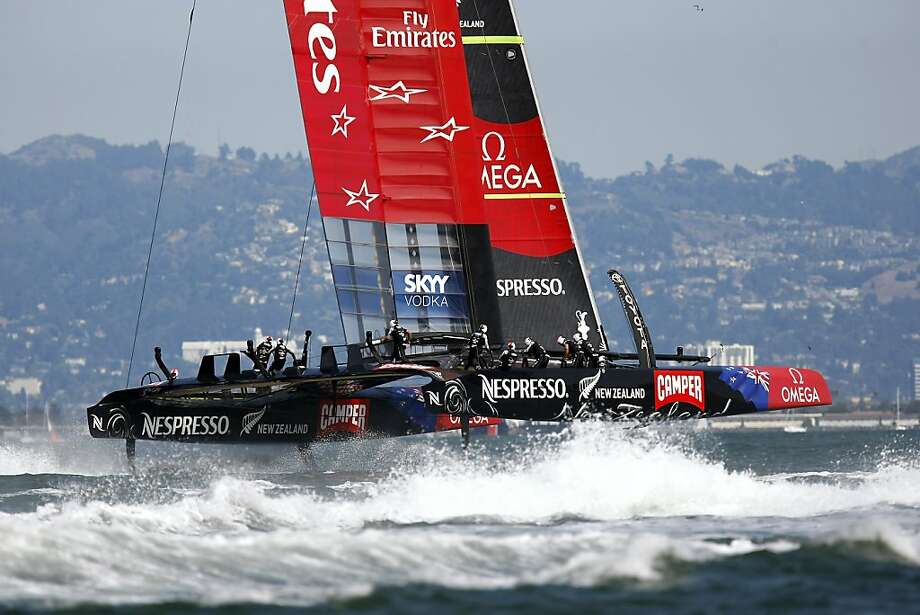 Emirates Team New Zealand zooms across San Francisco Bay in Race 6, eventually winning both of the day's contests. Photo: Michael Short, The Chronicle