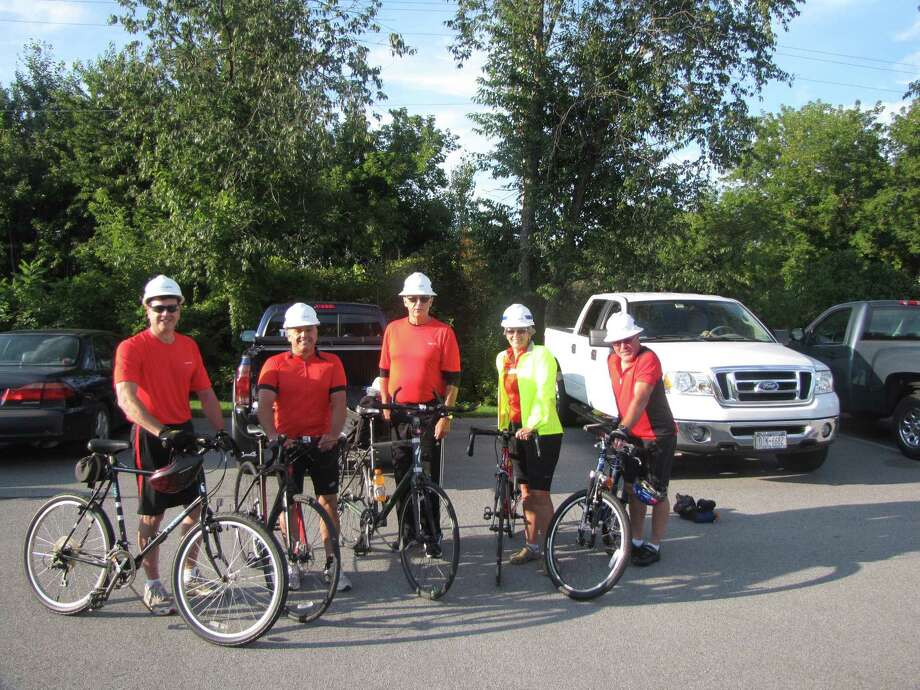 Cyclists from the National Grid Cystic Fibrosis Foundation Cycle for Life team pose with their bikes while sporting work helmets. From left are Michael Rooney, Patrick Esposito, Donald Thompson, Stacey Hughes and David Naske. (Stacey Hughes)