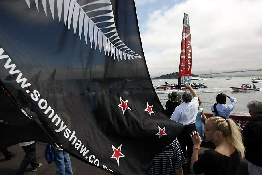 Fans watch as Emirates Team New Zealand's AC72 leaves the dock before the start of race number six of the America's Cup Finals in San Francisco, CA Thursday September 12, 2013. Photo: Michael Short, The Chronicle