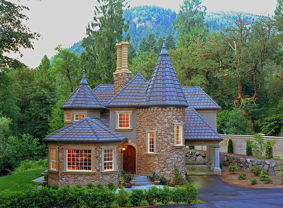 Want a home that's more than a metaphorical castle? Check out 12815 Issaquah-Hobart Road S.E., which was built in 1995 to resemble a European gatehouse. The 2,350-square-foot house has four bedrooms, 2.5 bathrooms, turrets, finials, cast stone chimneys, extensive stone and stucco, hand-carved mahogany entry doors, a concrete tile roof, travertine marble floors and coved ceilings on a 1.5-acre lot with 515 feet of frontage along a salmon-bearing creek and views of Squak Mountain. It's listed for $679,000. Photo: Matt Todd Architectural And Construction Photography