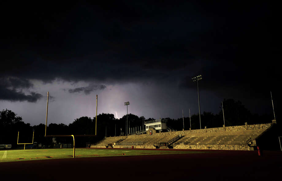 Lightning strikes to the north of Stamford High School on Thursday, Sept. 12, 2013. The game between Fairfield Prep and Stamford was postponed because of lightning, they will resume the game at 3:30 p.m. Friday. Photo: Jason Rearick / Stamford Advocate