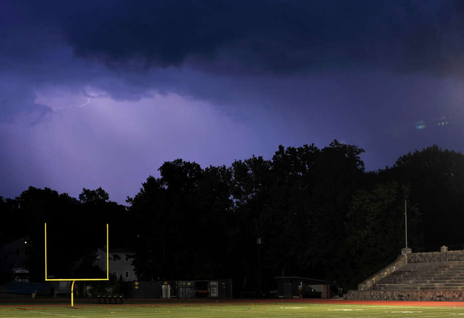 Lightning lights up the sky to the north of Stamford High School on Thursday, Sept. 12, 2013. The game between Fairfield Prep and Stamford was postponed because of lightning, they will resume the game at 3:30 p.m. Friday. Photo: Jason Rearick / Stamford Advocate