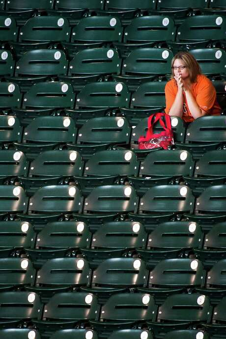 Greis Perez has plenty of room in section 124 at Minute Maid Park for most games as the Astros slide toward their third consecutive 100-loss season. Photo: Smiley N. Pool / © 2013  Smiley N. Pool