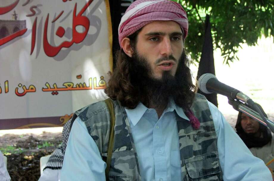 "FILE - In this Wednesday, May 11, 2011 file photo, American-born Islamist militant Omar Hammami addresses a press conference of the militant group al-Shabab at a farm in southern Mogadishu's Afgoye district in Somalia. Hammami, a jihadi from Alabama whose nom de guerre is Abu Mansoor Al-Amriki, or ""the American,"" and ascended the ranks of Somalia's al-Qaida-linked militant group al-Shabab high enough to attract a $5 million U.S. government bounty, was killed Thursday, Sept. 12, 2013 in an ambush ordered by the militant group's leader, militants said. (AP Photo/Farah Abdi Warsameh, File) ORG XMIT: NAI101 Photo: Farah Abdi Warsameh / AP"
