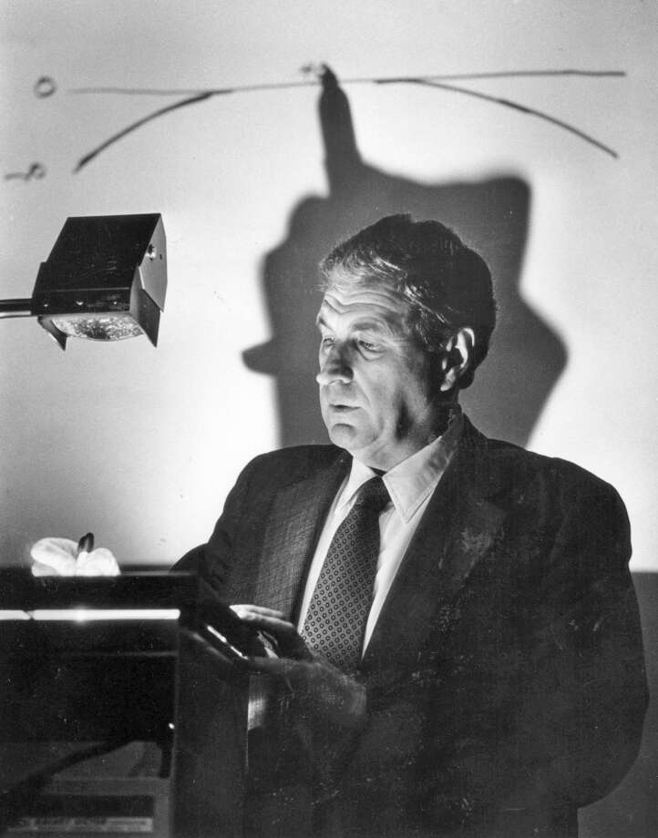 An April 7, 1986, file photo of Ray Dolby as he uses an overhead projector to explain his sound system to executives at the Academy of Motion Pictures in Los Angeles Photo: Ellen Jaskol, McClatchy-Tribune News Service