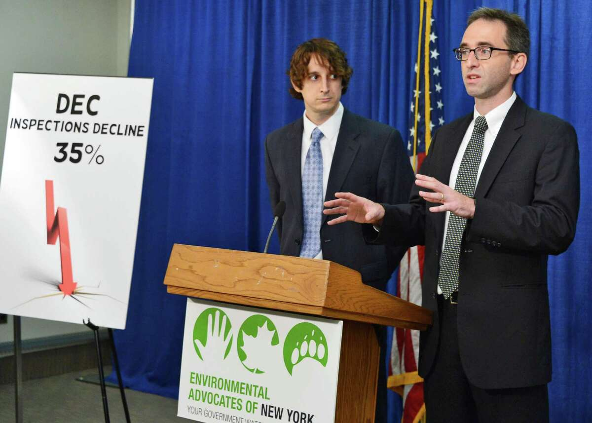 Andrew Postiglione, left, and Dave Gahl of Environmental Advocates of New York unveiled a report claiming that Cuomo budget cuts have endangered the environment during a news conference Thursday Sept. 12, 2013, at the Legislative Office Building in Albany, N.Y. (John Carl D'Annibale / Times Union)