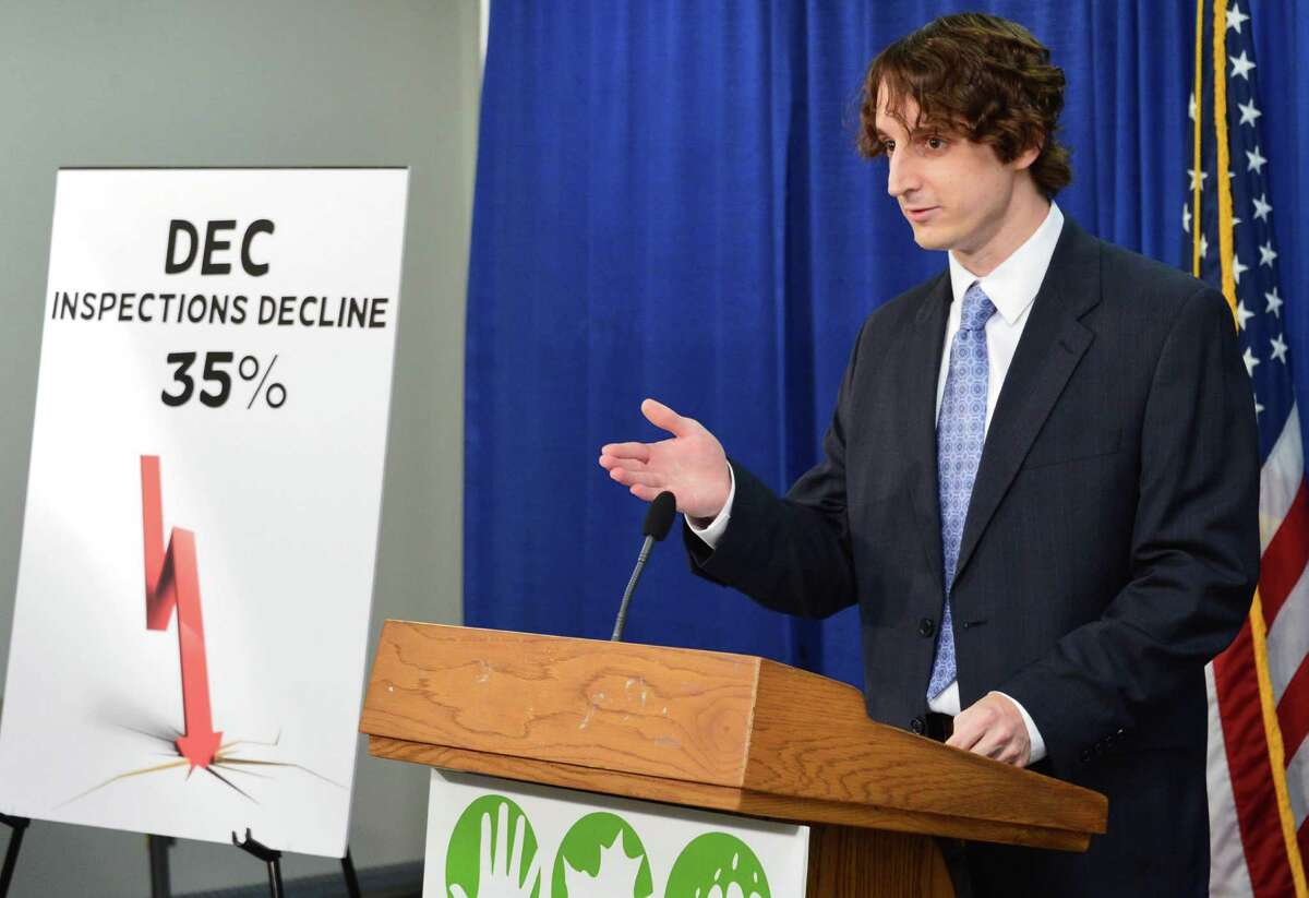 Andrew Postiglione of Environmental Advocates of New York unveiled a report which claimed that Cuomo budget cuts have endangered the environment during a news conference Thursday Sept. 12, 2013, at the Legislative Office Building in Albany, N.Y. (John Carl D'Annibale / Times Union)