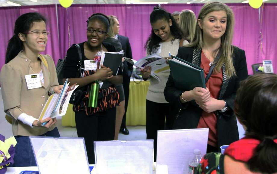 FILE - In this n April 4, 2012, file photo, Martina Ryberg, right, of Plymouth State University talks with Tara Rossetti of On Call International during a job fair for college students in Manchester, N.H. A report released Thursday, Sept. 12, 2013, shows that U.S. women have recovered all the jobs they lost during the Great Recession.  (AP Photo/Jim Cole) ORG XMIT: NYBZ145 Photo: Jim Cole / AP