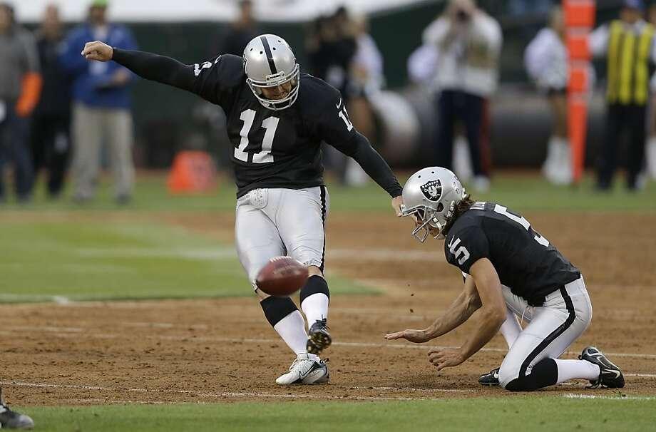 The Raiders' Sebastian Janikowski says he has no issues kicking on the dirt of the Coliseum infield. Photo: Marcio Jose Sanchez, Associated Press