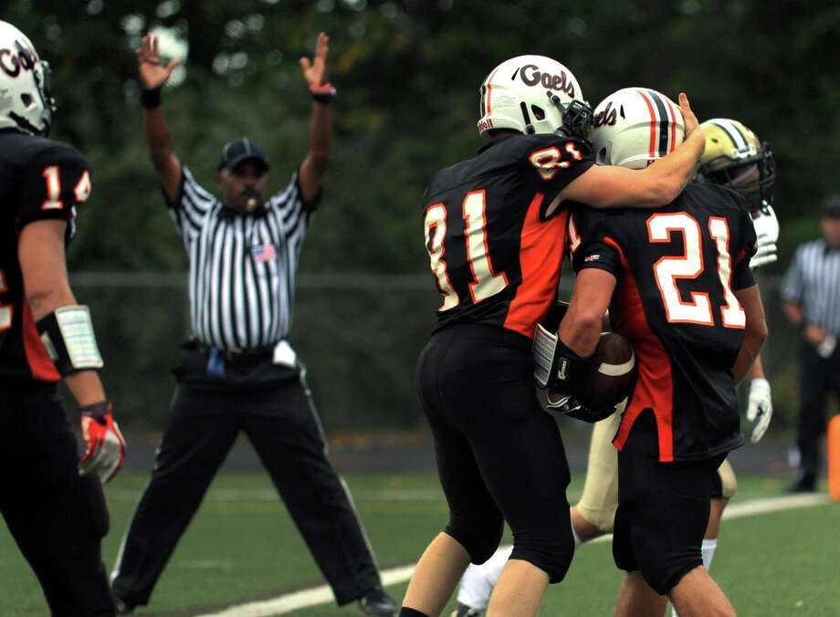 Shelton's Jason Thompson, right, celebrates a touchdown against Trumbull, during high school football action in Shelton, Conn. on Thursday September 12, 2013. Photo: Christian Abraham / Connecticut Post