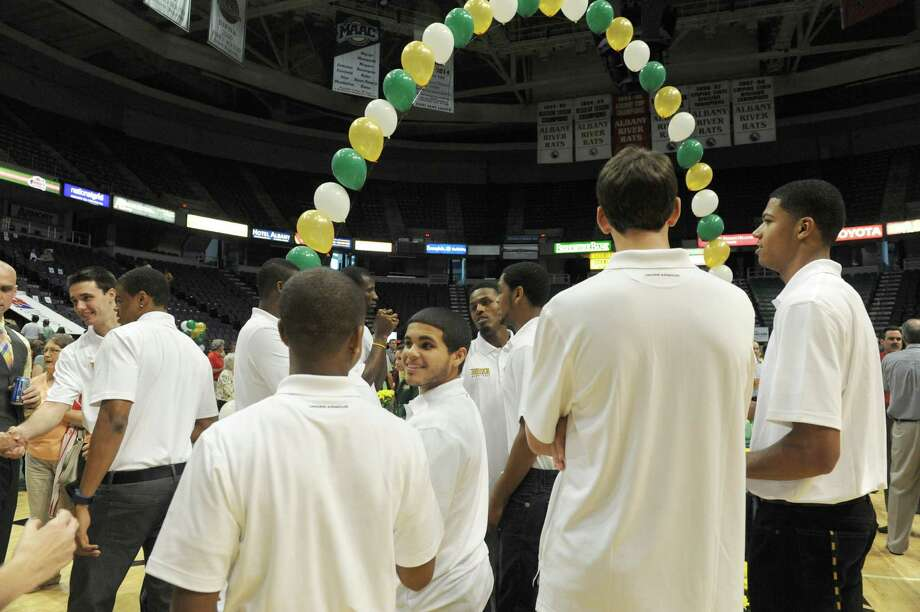 Siena men's basketballplayers gather during Siena's annual Sneak Preview, where fans get to meet and greet the men's and women's teams at the Times Union Center on Thursday Sept. 12, 2013 in Albany N.Y. (Michael P. Farrell/Times Union) Photo: Michael P. Farrell / 00023841A