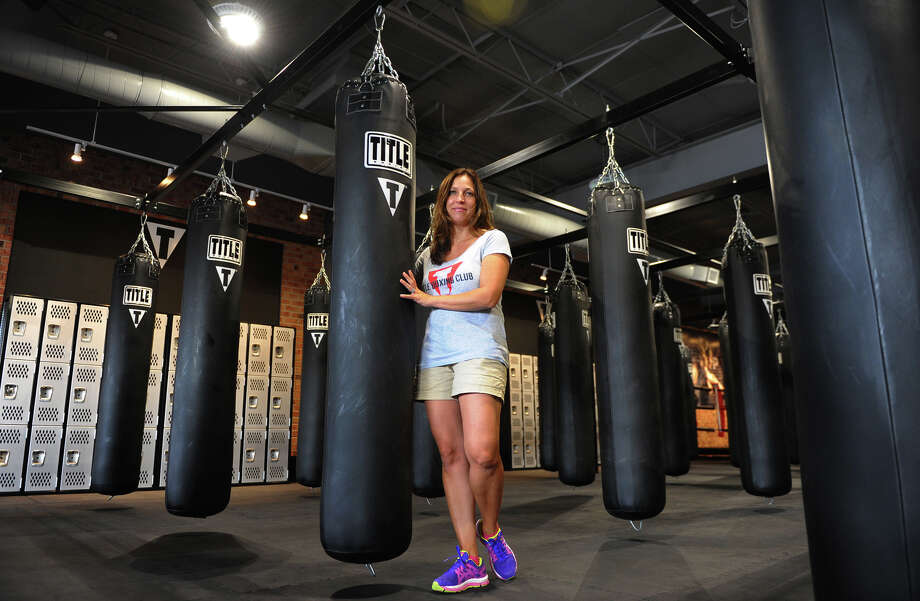 Owner Jen Fallot at the Title Boxing Club in Milford, Conn. on Thursday September 12, 2013. The club is a fitness club that offers a combination of boxing and kickboxing classes called the Power Hour, and recently opened in the Milford Plaza. Photo: Christian Abraham / Connecticut Post