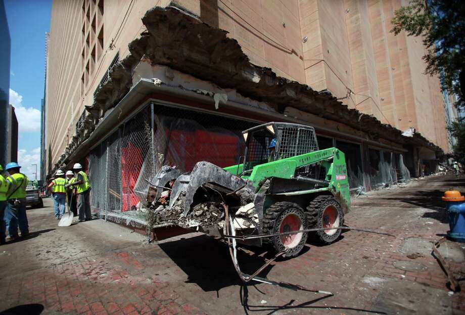 Crews prepare the downtown Macy's building for implosion. News in January of the department store's closure was a blow to downtown and prompted the mayor to form the Downtown Retail Task Force. Photo: Mayra Beltran, Staff / © 2013 Houston Chronicle
