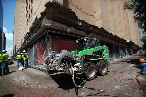 Crews prepare the downtown Macy's building for implosion. News in January of the department store's closure was a blow to downtown and prompted the mayor to form the Downtown Retail Task Force.