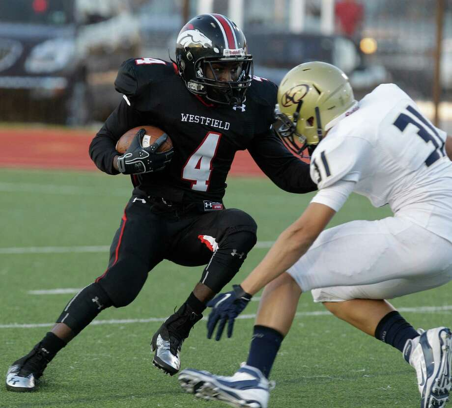 Westfield 38, Klein Collins 31Brain Peavy of Westfield works to carry ball past Santiago Montoya of Klein Collins during the first quarter. Photo: Melissa Phillip, Houston Chronicle / © 2013  Houston Chronicle