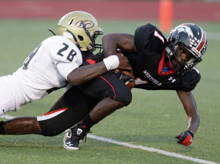 Quintrell Webster of Klein Collins cannot stop a touchdown by Tevin Lewis of Westfield. Photo: Melissa Phillip, Houston Chronicle / © 2013  Houston Chronicle