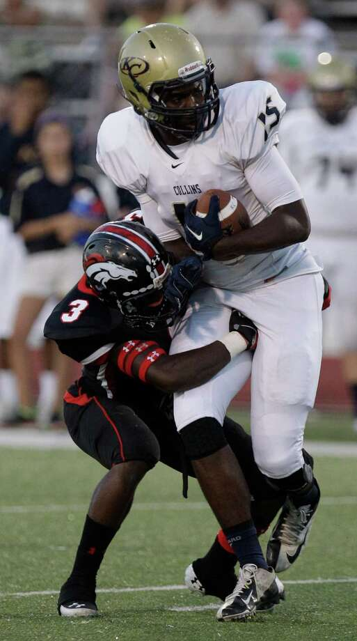 Johmarco Kizzie of Westfield tackles Cameron Green of Klein Collins during the first quarter. Photo: Melissa Phillip, Houston Chronicle / © 2013  Houston Chronicle
